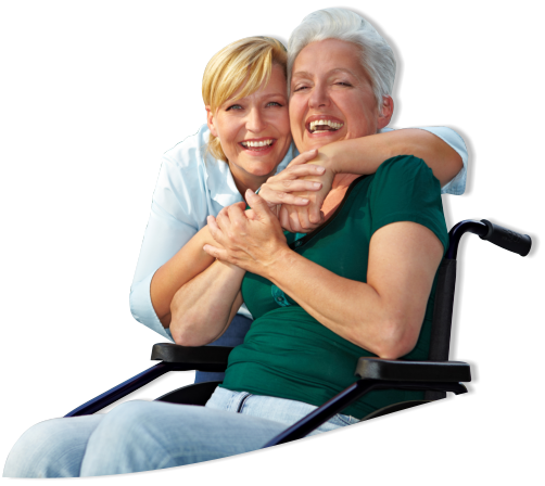 caregiver hugging patient in a wheelchair